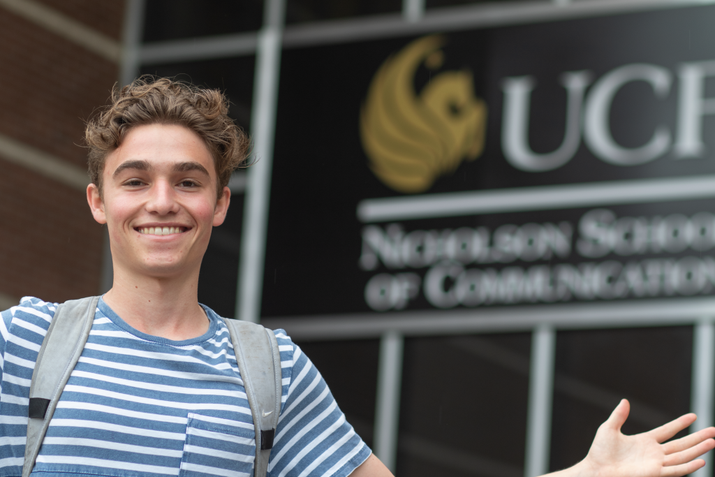 Henry Byrne stands outside the UCF Nicholson School of Communication.